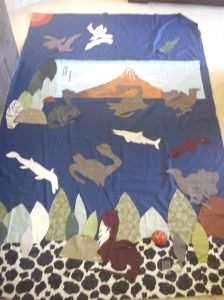 Small fry requested a dinosaur bedspread..this is what he got.
